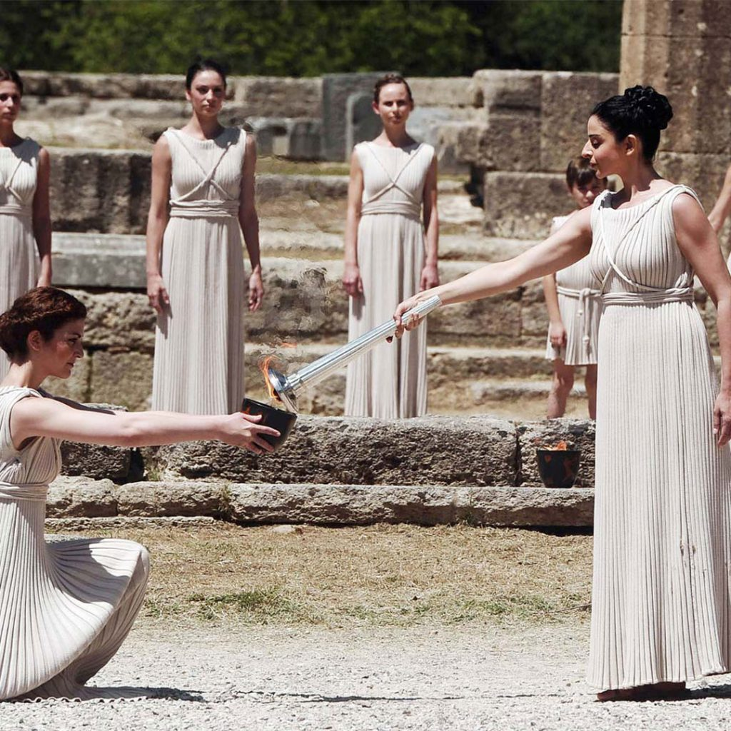 Discover Mythical Peloponnese_Priestesses light the olympic flame_ancient olympia